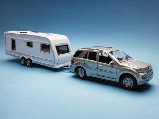 Toy car towing a caravan