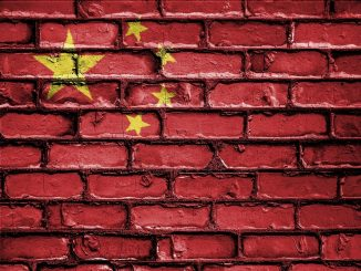 chinese flag on brick wall