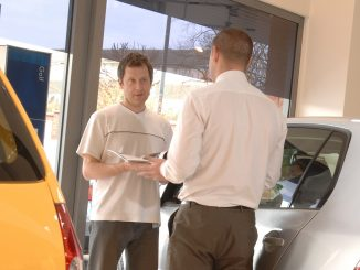 car buyer in showroom